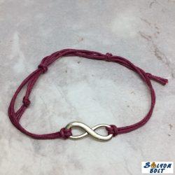 Zsinóros karkötő lila színben, végtelen medállal, kézműves termék